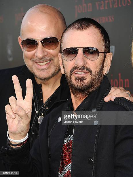 Designer John Varvatos and Ringo Starr attend the International Peace Day celebration at John Varvatos on September 21 2014 in Los Angeles California