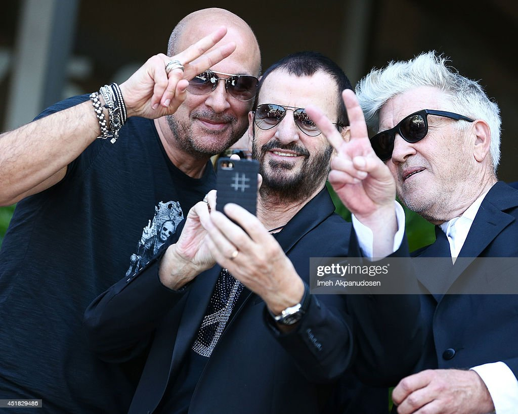 Designer <a gi-track='captionPersonalityLinkClicked' href=/galleries/search?phrase=John+Varvatos+-+Fashion+Designer&family=editorial&specificpeople=4689295 ng-click='$event.stopPropagation()'>John Varvatos</a>, musician <a gi-track='captionPersonalityLinkClicked' href=/galleries/search?phrase=Ringo+Starr&family=editorial&specificpeople=92463 ng-click='$event.stopPropagation()'>Ringo Starr</a>, and director <a gi-track='captionPersonalityLinkClicked' href=/galleries/search?phrase=David+Lynch&family=editorial&specificpeople=224589 ng-click='$event.stopPropagation()'>David Lynch</a> attend the announcement of special collaboration of <a gi-track='captionPersonalityLinkClicked' href=/galleries/search?phrase=John+Varvatos+-+Fashion+Designer&family=editorial&specificpeople=4689295 ng-click='$event.stopPropagation()'>John Varvatos</a> and <a gi-track='captionPersonalityLinkClicked' href=/galleries/search?phrase=Ringo+Starr&family=editorial&specificpeople=92463 ng-click='$event.stopPropagation()'>Ringo Starr</a> on occasion of Ringo's birthday at Capitol Records Studio on July 7, 2014 in Hollywood, California.