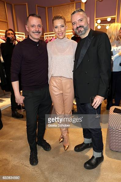 Designer Johnny Talbot Marisa Leonie Bach wearing an outfit by Talbot Runhof and designer Adrian Runhof during the Talbot Runhof boutique opening at...