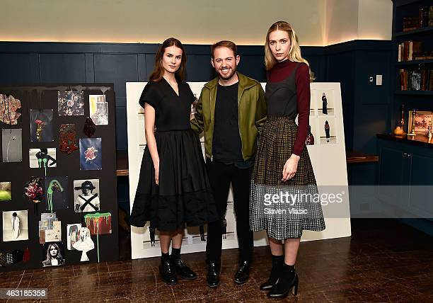 Designer Jonathan Cohen poses with models wearing his new collection at Jonathan Cohen Presentation during MercedesBenz Fashion Week Fall 2015 at...
