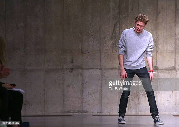 Designer Jonathan William Anderson walks the runway at the JW Anderson show during London Fashion Week Fall/Winter 2013/14 at TopShop Show Space on...