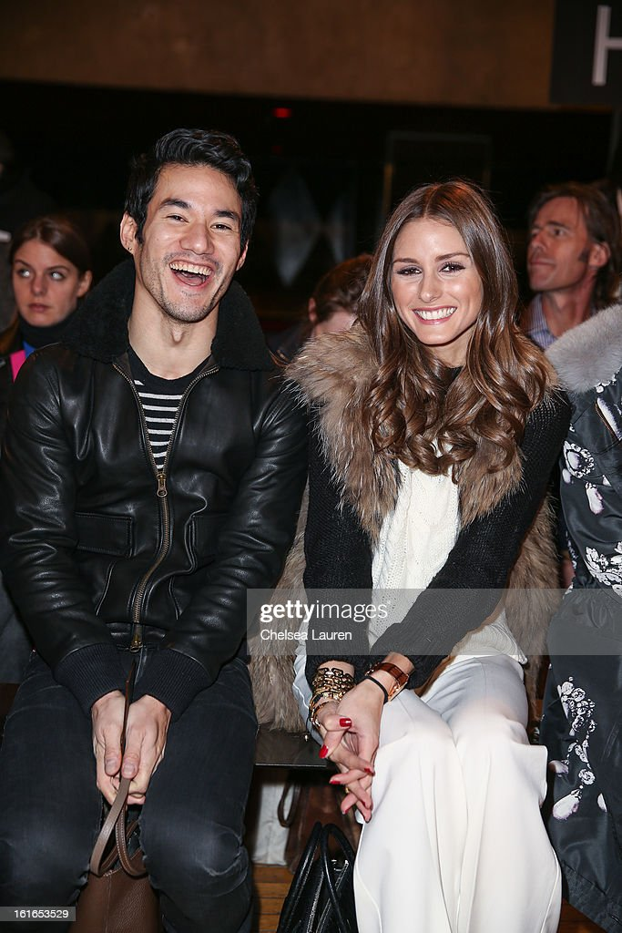 Designer Joseph Altuzarra (L) and TV personality Olivia Palermo attend the Philosophy By Natalie Ratabesi fall 2013 fashion show during Mercedes-Benz Fashion Week at Roseland Ballroom on February 13, 2013 in New York City.