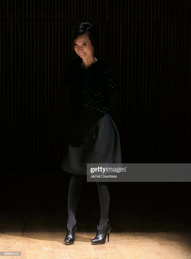 Designer <a gi-track='captionPersonalityLinkClicked' href=/galleries/search?phrase=Josie+Natori&family=editorial&specificpeople=1361603 ng-click='$event.stopPropagation()'>Josie Natori</a> walks the runway at the <a gi-track='captionPersonalityLinkClicked' href=/galleries/search?phrase=Josie+Natori&family=editorial&specificpeople=1361603 ng-click='$event.stopPropagation()'>Josie Natori</a> Fall 2014 fashion show at Dimenna Center for Classical Music on February 5, 2014 in New York City.