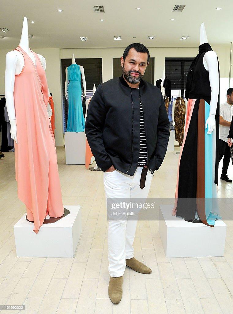designer juan carlos obando attends juan carlos obando and his exclusive eveningwear collection. Black Bedroom Furniture Sets. Home Design Ideas