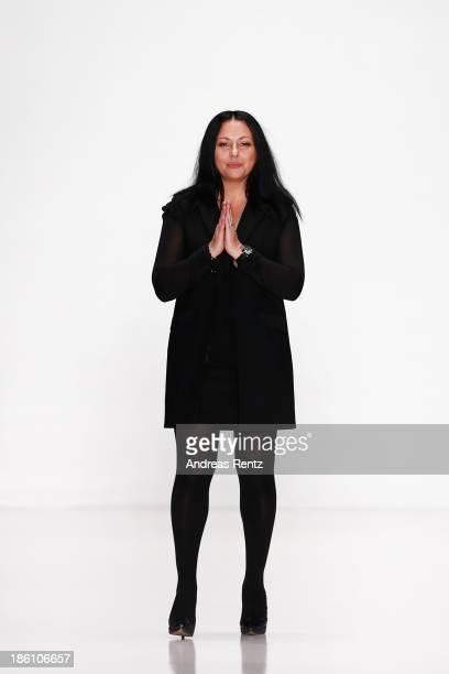 Designer Julia Dalakian appears on the runway at the end of the Julia Dalakian show during MercedesBenz Fashion Week Russia S/S 2014 on October 28...