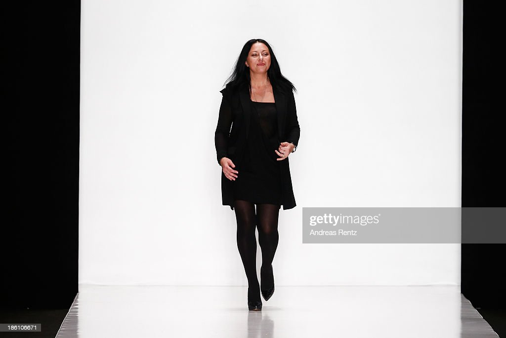 Designer Julia Dalakian appears on the runway at the end of the Julia Dalakian show during Mercedes-Benz Fashion Week Russia S/S 2014 on October 28, 2013 in Moscow, Russia.
