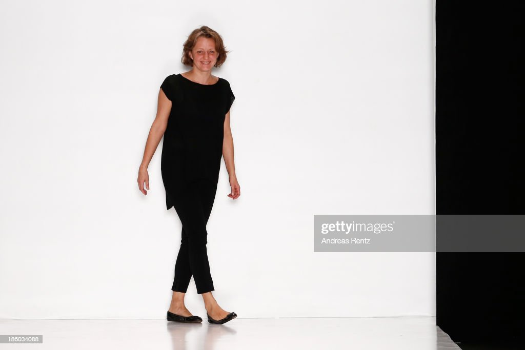 Designer Julia Nikolaeva acknowledges the applause of the audience after the Julia Nikolaeva show during Mercedes-Benz Fashion Week Russia S/S 2014 on October 27, 2013 in Moscow, Russia.