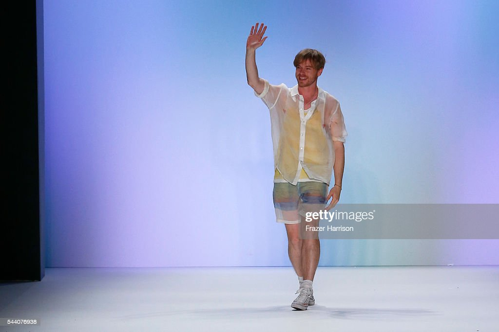 Designer Julian Zigerli acknowledges the applause of the audience at the Julian Zigerli show during the Mercedes-Benz Fashion Week Berlin Spring/Summer 2017 at Erika Hess Eisstadion on July 1, 2016 in Berlin, Germany.