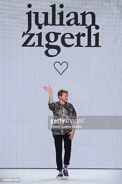 Designer Julian Zigerli walks the runway at the Julian Zigerli show during the MercedesBenz Fashion Days Zurich 2014 on November 12 2014 in Zurich...