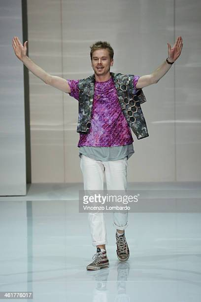 Designer Julian Zigerli walks the runway during the Julian Zigerli show as a part of Milan Fashion Week Menswear Autumn/Winter 2014 on January 11...
