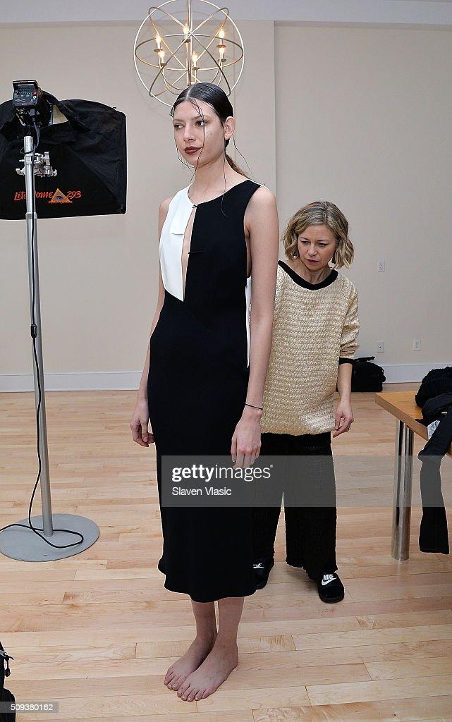 Designer Julie Haus attends models preparation backstage at Haus Alkire Presentation during Fall 2016 New York Fashion Week on February 10, 2016 in New York City.