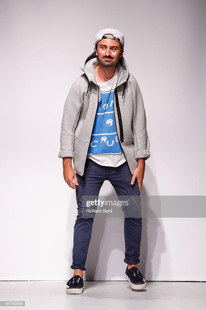 Designer Julien David walks the runway after the Julien David show as part of the Paris Fashion Week Womenswear Spring/Summer 2014 on September 24, 2013 in Paris, France.