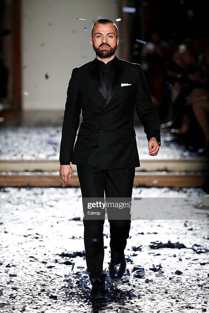 Designer Julien Fournié walks the runway during the Julien Fournie Haute Couture Fall/Winter 20162017 show as part of Paris Fashion Week on July 5...