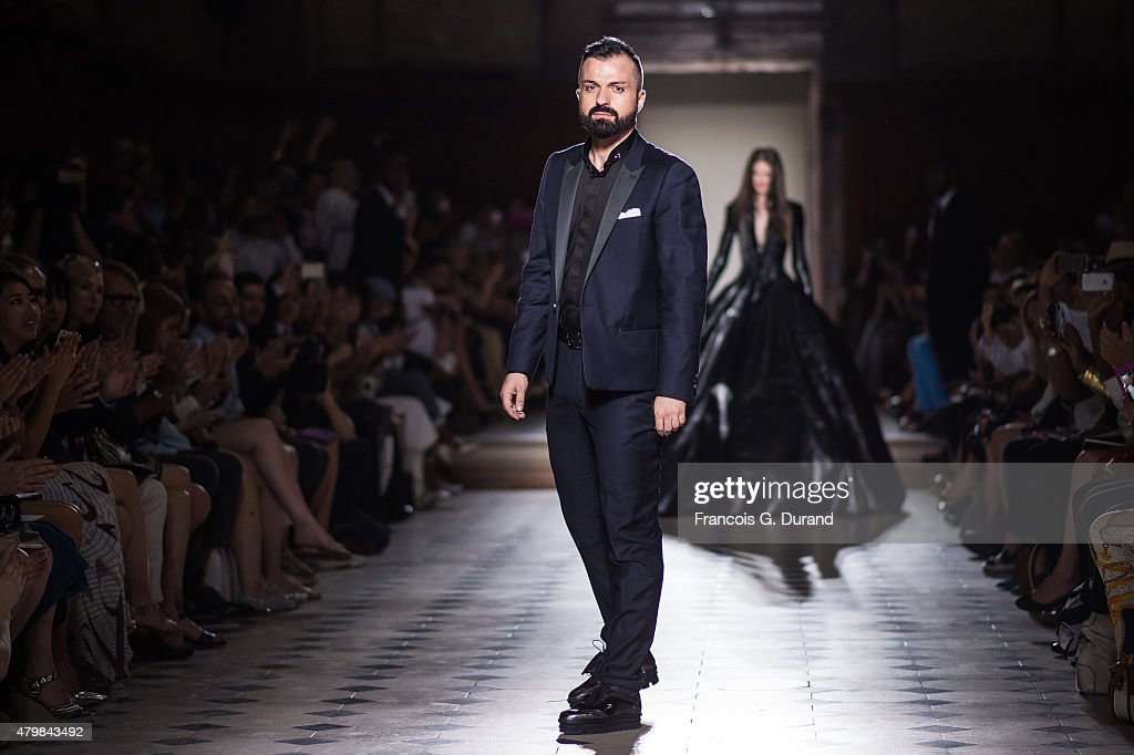 Designer Julien Fournie aknowledges the public after his show as part of Paris Fashion Week Haute Couture Fall/Winter 2015/2016 on July 7 2015 in...
