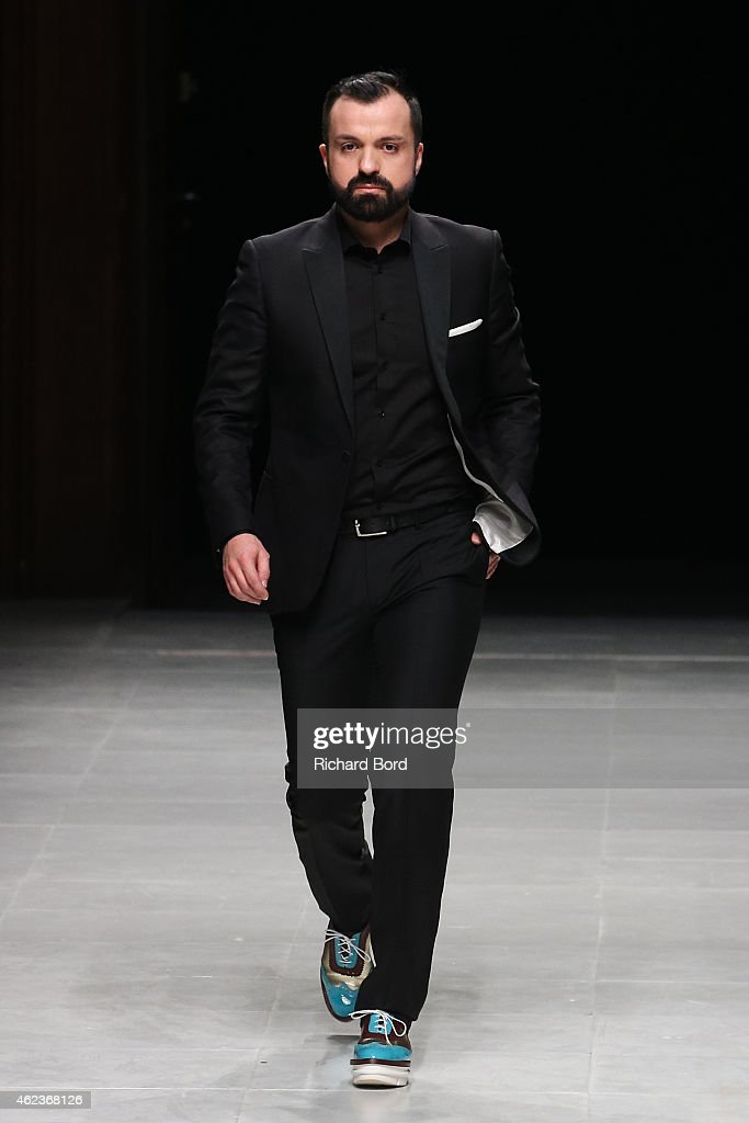 Designer Julien Fournier walks the runway after the Julien Fournie show as part of the Paris Fashion Week Haute Couture Spring/Summer 2015 at Palais des Beaux Arts on January 27, 2015 in Paris, France.