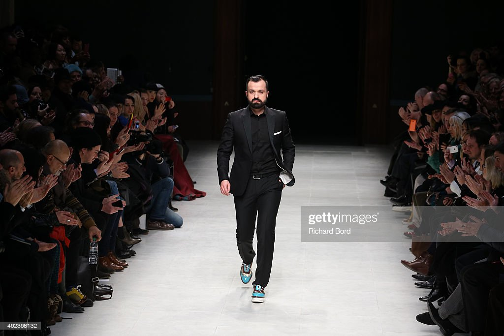 Designer Julien Fournier walks the runway after the Julien Fournie show as part of the Paris Fashion Week Haute Couture Spring/Summer 2015 at Palais...