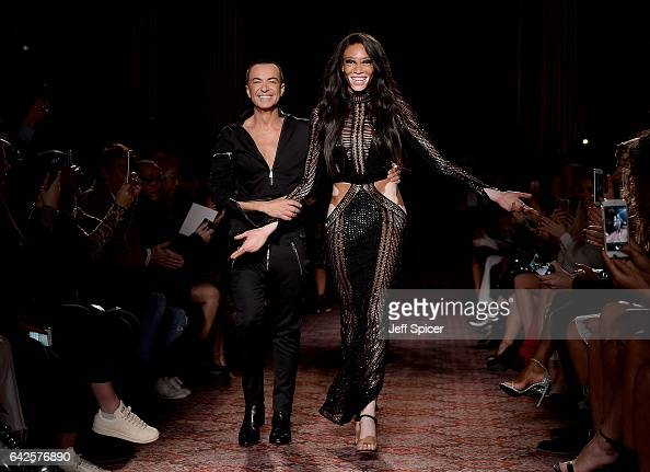 Designer Julien Macdonald and model Winnie Harlow walk the runway at the Julien Macdonald show during the London Fashion Week February 2017...