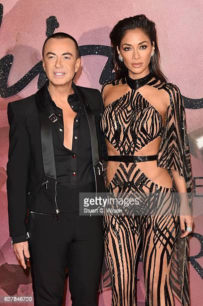 Designer Julien Macdonald and singer Nicole Scherzinger attend The Fashion Awards 2016 on December 5 2016 in London United Kingdom