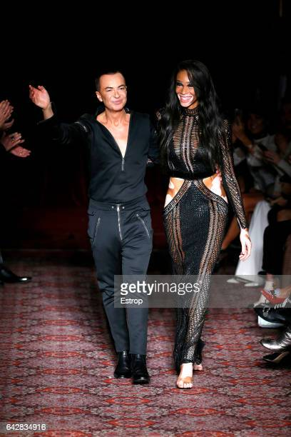 Designer Julien Macdonald and Winnie Harlow walking the runway at the Julien Macdonald show during the London Fashion Week February 2017 collections...