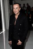 Designer Julien Macdonald attends the Versus show during London Fashion Week SS16 on September 19 2015 in London England