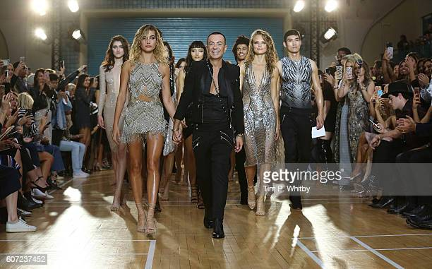 Designer Julien Macdonald surrounded by models during the finale on the runway at the Julien Macdonald show during London Fashion Week Spring/Summer...