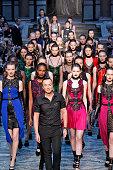 Designer Julien Macdonald walks the runway at the Julien Macdonald show during London Fashion Week Fall/Winter 2015/16 at The Banking Hall on...