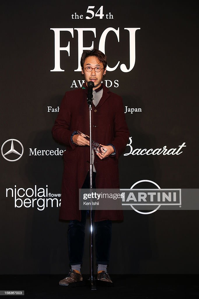 Designer Jun Takahashi of Undercover receives the Designer of the Year award during the 54th Fashion Editors Club of Japan Awards at Mercedes-Benz Connection on December 14, 2012 in Tokyo, Japan.