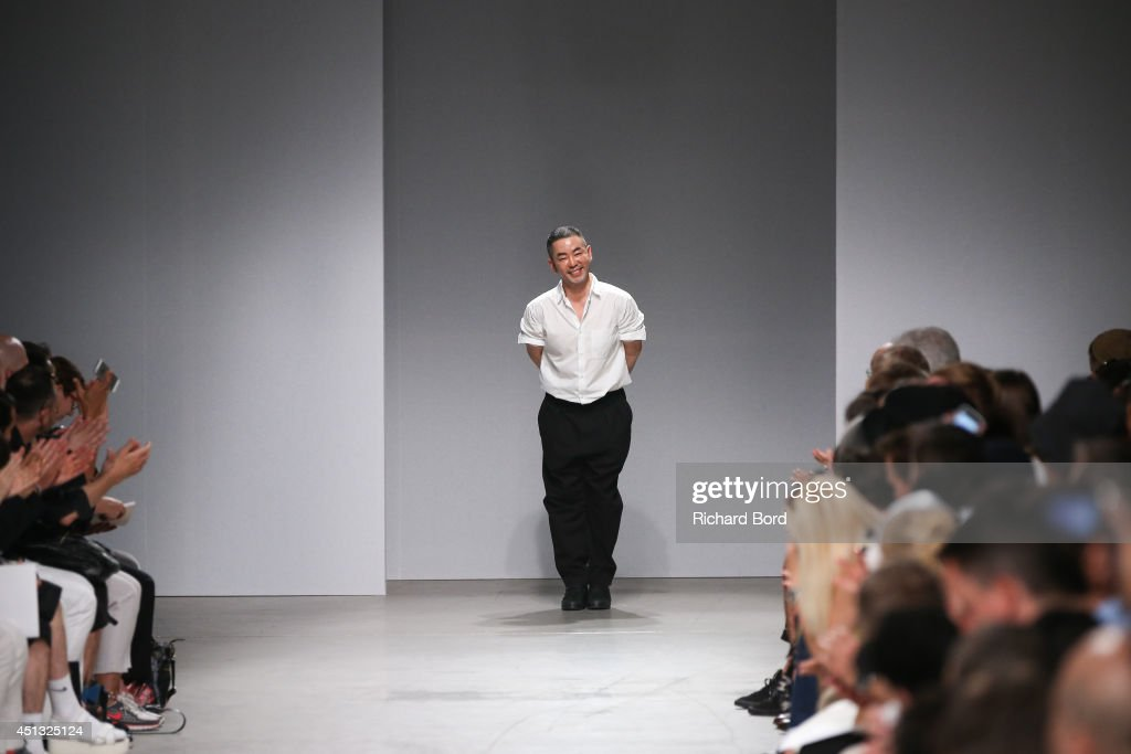 Designer Juun J walks the runway after the Juun J show as part of the Paris Fashion Week Menswear Spring/Summer 2015 at Palais de Tokyo on June 27, 2014 in Paris, France.