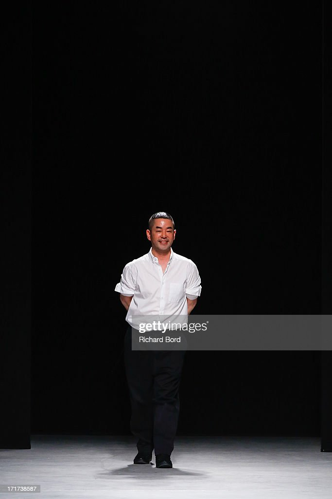 Designer Juun J. walks the runway during the Juun.J Menswear Spring/Summer 2014 show at Palais de Tokyo as part of the Paris Fashion Week on June 28, 2013 in Paris, France.