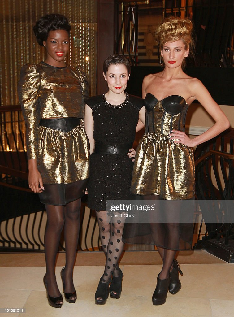 Designer Kahrianne Kerr of Kahri poses with models in Kahri at the Caravan Stylist Studio New York Presentation at the Carlton Hotel on February 12, 2013 in New York City.