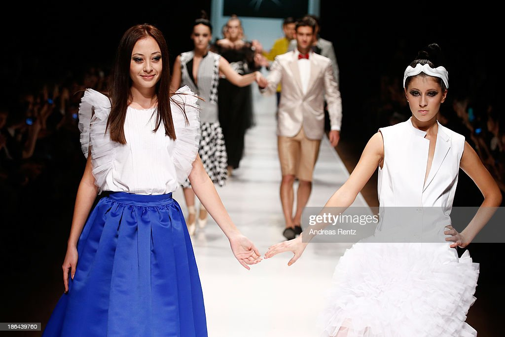 Designer Kamila Kurbani appears with models on stage at the Kamila Kurbani show during Mercedes-Benz Fashion Week Russia S/S 2014 on October 31, 2013 in Moscow, Russia.