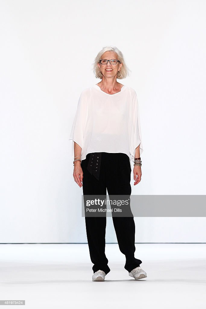 Designer Karin Veit walks the runway at the Marc Cain show during the MercedesBenz Fashion Week Spring/Summer 2015 at Erika Hess Eisstadion on July...