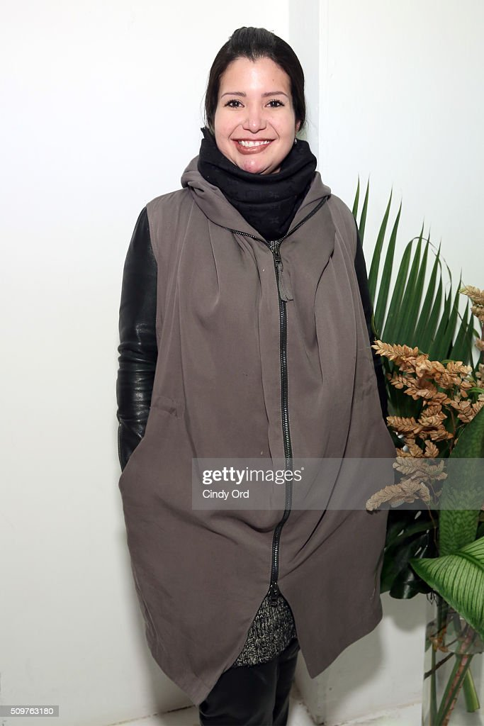 Designer, Karina Gamez, poses backstage at the Karigam Fall 2016 fashion show during New York Fashion Week: The Shows at The Space, Skylight at Clarkson Sq on February 12, 2016 in New York City.