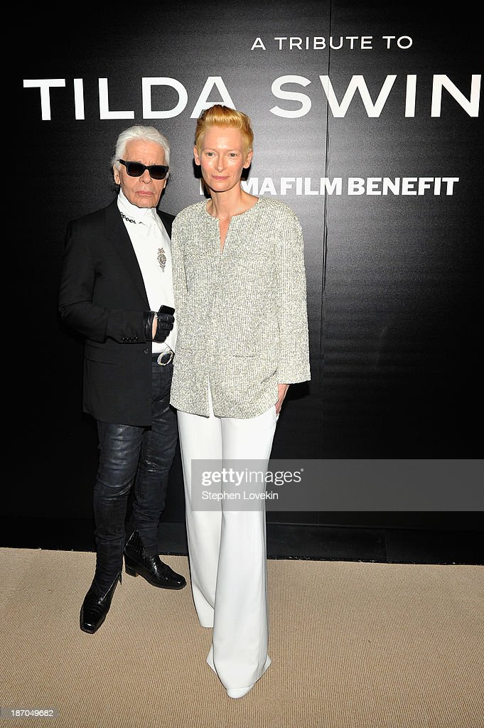 Designer <a gi-track='captionPersonalityLinkClicked' href=/galleries/search?phrase=Karl+Lagerfeld+-+Fashion+Designer&family=editorial&specificpeople=4330565 ng-click='$event.stopPropagation()'>Karl Lagerfeld</a> and actress <a gi-track='captionPersonalityLinkClicked' href=/galleries/search?phrase=Tilda+Swinton&family=editorial&specificpeople=202991 ng-click='$event.stopPropagation()'>Tilda Swinton</a> attend The Museum of Modern Art Film Benefit: A Tribute to <a gi-track='captionPersonalityLinkClicked' href=/galleries/search?phrase=Tilda+Swinton&family=editorial&specificpeople=202991 ng-click='$event.stopPropagation()'>Tilda Swinton</a> reception at Museum of Modern Art on November 5, 2013 in New York City.