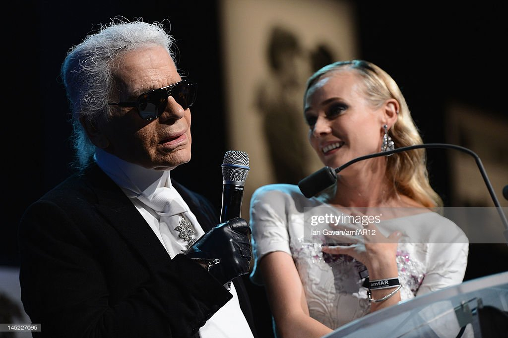 Designer <a gi-track='captionPersonalityLinkClicked' href=/galleries/search?phrase=Karl+Lagerfeld+-+Fashion+Designer&family=editorial&specificpeople=4330565 ng-click='$event.stopPropagation()'>Karl Lagerfeld</a> and <a gi-track='captionPersonalityLinkClicked' href=/galleries/search?phrase=Diane+Kruger&family=editorial&specificpeople=202640 ng-click='$event.stopPropagation()'>Diane Kruger</a> attend the 2012 amfAR's Cinema Against AIDS during the 65th Annual Cannes Film Festival at Hotel Du Cap on May 24, 2012 in Cap D'Antibes, France.