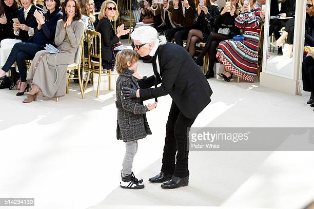Designer Karl Lagerfeld and his godson Hudson Kroenig walk the runway during the Chanel show as part of the Paris Fashion Week Womenswear Fall/Winter...