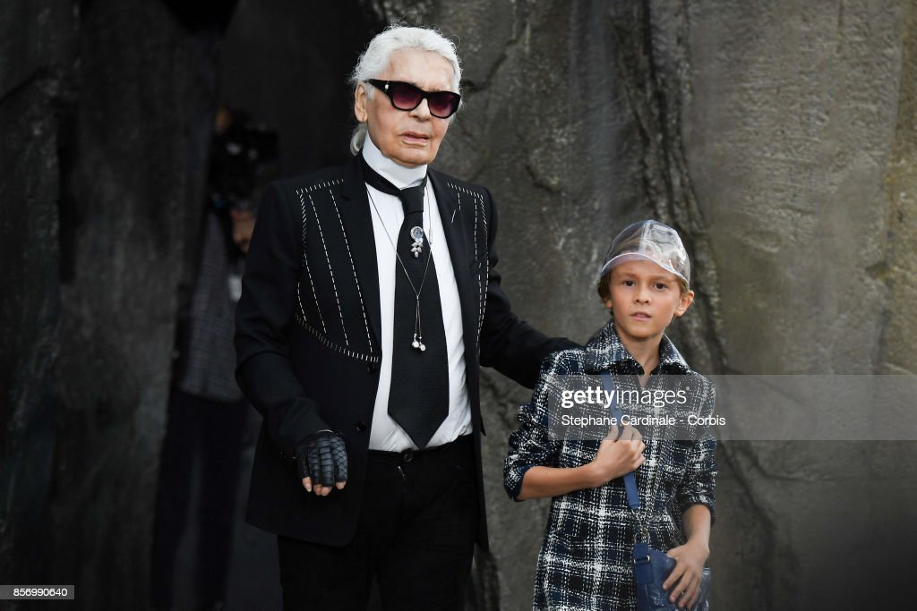 Designer Karl Lagerfeld and Hudson Kroenig walk the runway during the Chanel Spring Summer 2018 show as part of Paris Fashion Week at on October 3, 2017 in Paris, France.