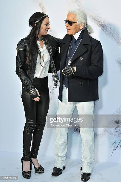 Designer Karl Lagerfeld and Lindsay Lohan attend the Chanel Ready to Wear show as part of the Paris Womenswear Fashion Week Fall/Winter 2011 at Grand...