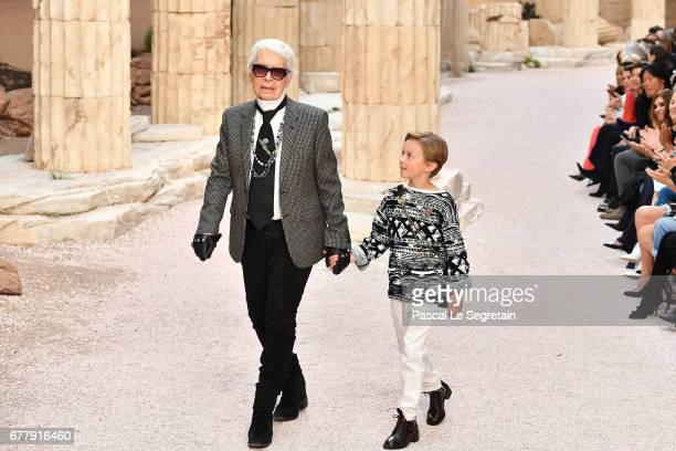 Designer Karl Lagerfeld and nephew Hudson Kroenig walk the runway during Chanel Cruise 2017/2018 Collection at Grand Palais on May 3 2017 in Paris...