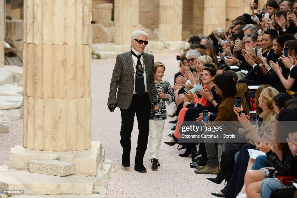 Designer Karl Lagerfeld and nephew Hudson Kroenig walk the runway, Charlotte Casiraghi (R) is seen in the public, during the Chanel Cruise 2017/2018 Collection at Grand Palais on May 3, 2017 in Paris, France.