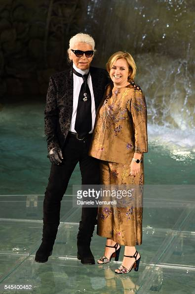 Designer Karl Lagerfeld and Silvia Venturini Fendi acknowledging the applause of the public after the runway at Fendi Roma 90 Years Anniversary...