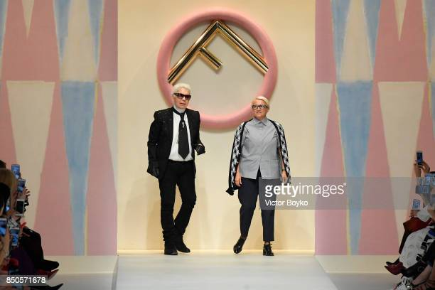 Designer Karl Lagerfeld and Silvia Venturini Fendi acknowledging the applause of the public after the Fendi show during Milan Fashion Week...