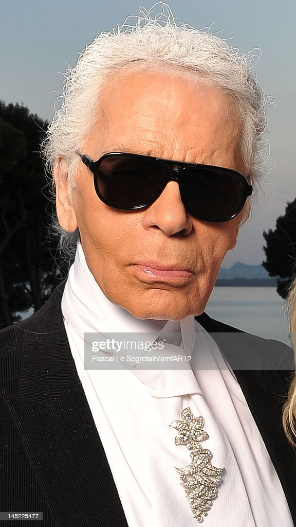 Designer Karl Lagerfeld attends the 2012 amfAR's Cinema Against AIDS during the 65th Annual Cannes Film Festival at Hotel Du Cap on May 24, 2012 in Cap D'Antibes, France.