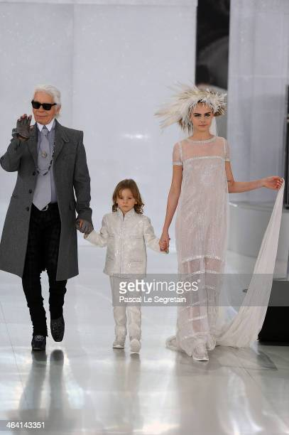 Designer Karl Lagerfeld his godson Hudson Kroenig and model Cara Delevingne walk the runway during the Chanel show as part of Paris Fashion Week...