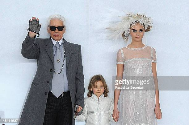 Designer Karl Lagerfeld his godson Hudson Kroenig and model Cara Delevingne walk the runway during the Chanel show as part of Paris Fashion Week...