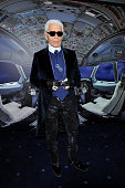 Designer Karl Lagerfeld poses for photographs during the Chanel 2012 Spring/Summer Haute Couture Collection Show at Shinjuku Gyoen Park on March 22...