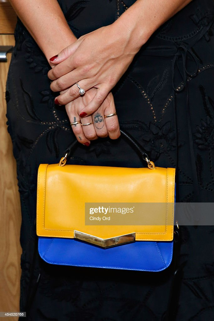Designer Kate Foley (bag detail) poses for a photo at the Time's Arrow + Kate Foley Presentation during Mercedes-Benz Fashion Week Spring 2015 at Miss Lily's on September 2, 2014 in New York City.