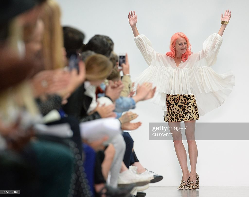 Designer Katie Eary acknowledges the applause following a fashion show of her creations on the fourth day of the Spring/Summer 2016 London...