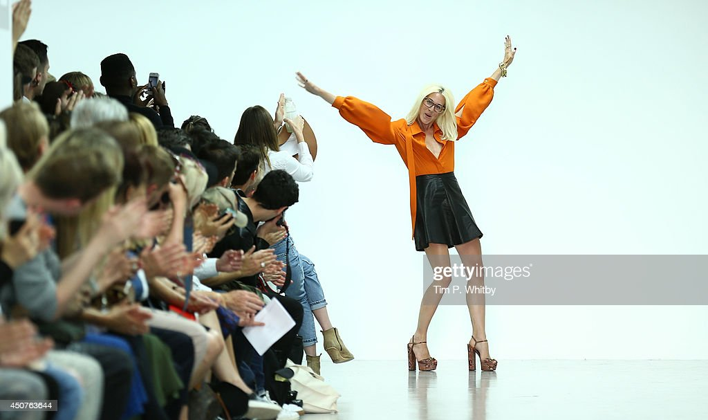 Designer Katie Eary poses on the runway at the Katie Eary show during the London Collections Men SS15 at Victoria House on June 17 2014 in London...