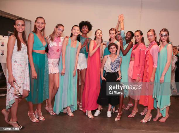 Designer Katty Xiomara poses with models at Katty Xiomara Backstage September 2017 during New York Fashion Week at Pier 59 on September 11 2017 in...